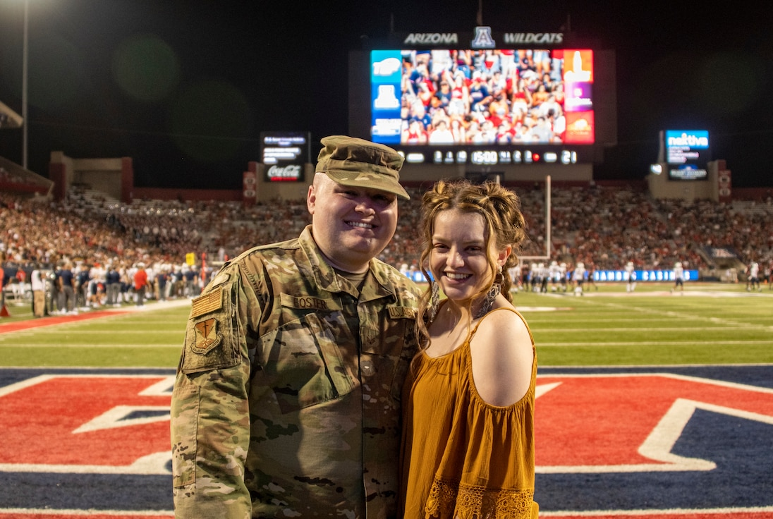 A photo of the hometown hero with his wife posing for the camera.