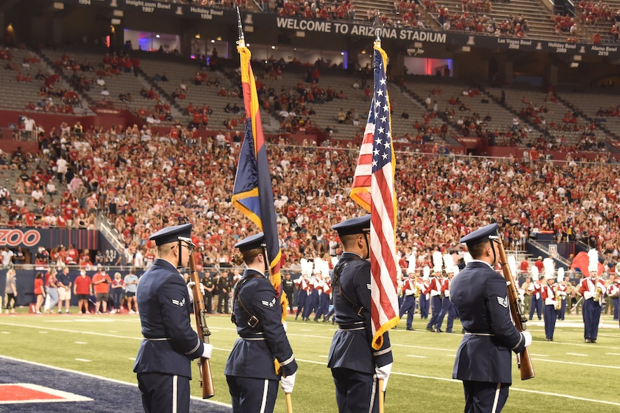 A picture of honor guard presenting the colors at a University of Arizona football game.