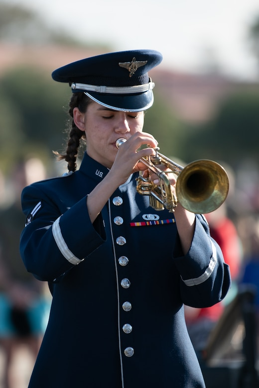 Airman playing trumpet