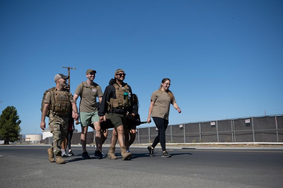 Airmen running with ruck sack