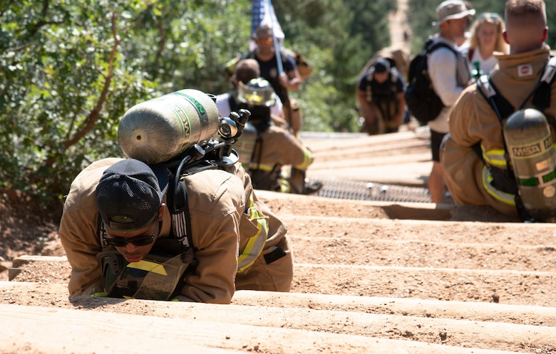 A Cheyenne Mountain Space Force Station firefighter rests during his climb up the Manitou Incline.