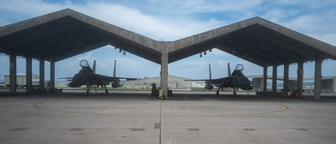 U.S. Air Force Airmen from the 67th Aircraft Maintenance Unit prepare for pre-flight inspections of an F-15C eagle at Kadena Air Base, Japan, Sept. 14, 2021. The 18th Wing is home to the 67th and 44th Fighter Squadrons. (U.S. Air Force photo by Airman 1st Class Stephen Pulter)