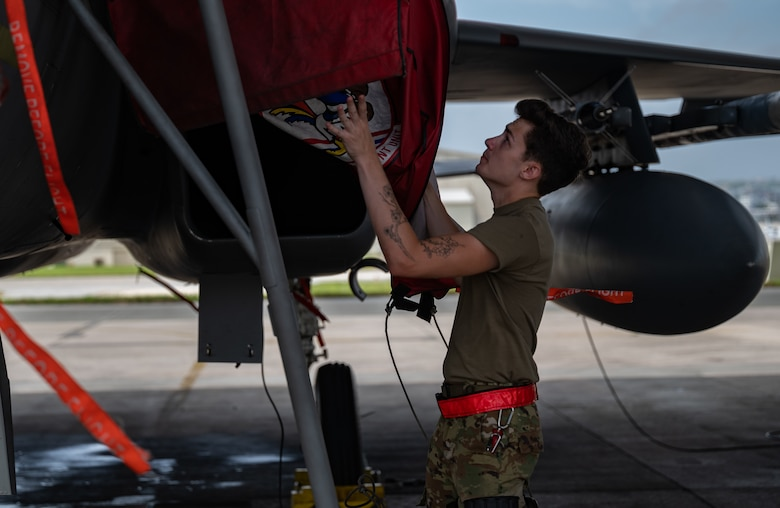 U.S. Air Force Airman 1st Class Zach Huschley, 67th Aircraft Maintenance Unit aerospace propulsion engineer, removes an intake cover at Kadena Air Base, Japan, Sept. 14, 2021. The F-15C Eagle is an all-weather, extremely maneuverable, tactical fighter designed to permit the Air Force to gain and maintain air supremacy over the battlefield. (U.S. Air Force photo by Airman 1st Class Stephen Pulter)