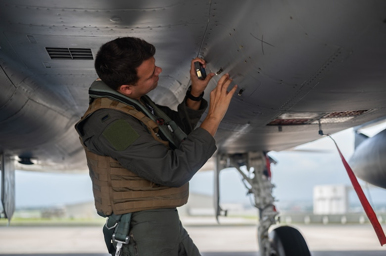 U.S. Air Force 1st Lt. Sebastian Coburn, 44th Fighter Squadron F-15C Eagle pilot, inspects an F-15C Eagle at Kadena Air Base, Japan, Sept. 14, 2021. The F-15C's superior maneuverability and acceleration are achieved through high engine thrust-to-weight ratio and low wing-loading. (U.S. Air Force photo by Airman 1st Class Stephen Pulter)