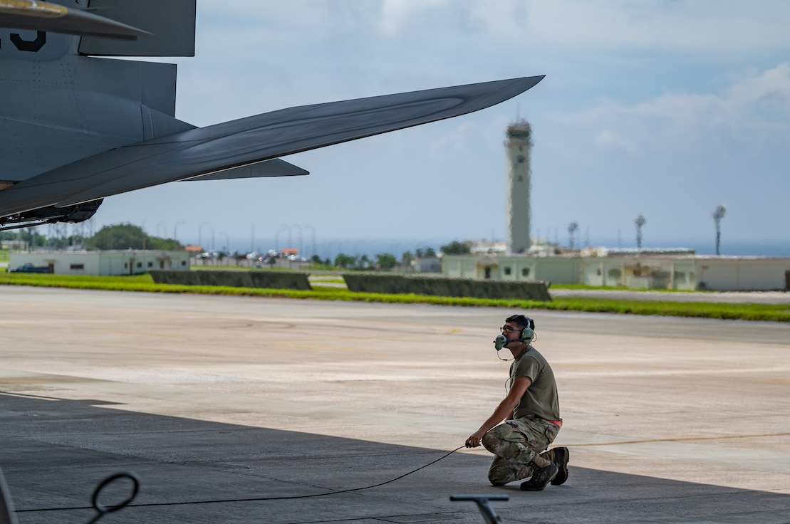 U.S. Air Force Airman 1st Class Joel Hernandez, 67th Aircraft Maintenance Unit crew chief, conducts preflight checks on an F-15C Eagle at Kadena Air Base, Japan, Sept. 14, 2021. Crew chiefs are responsible for day-to-day maintenance, including end-of-runway, post-flight, preflight, thru-flight, special inspections and phase inspections. (U.S. Air Force photo by Airman 1st Class Stephen Pulter)