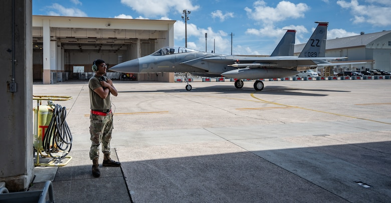 U.S. Air Force Airman 1st Class Joel Hernandez, 67th Aircraft Maintenance Unit crew chief, signals to the pilot of an F-15C Eagle at Kadena Air Base, Japan, Sept. 14, 2021. The life of a dedicated crew chief requires non-stop dedication, day and night, to maintain air-to-air combat superiority. (U.S. Air Force photo by Airman 1st Class Stephen Pulter)