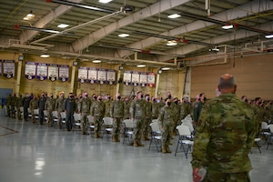 Airmen standing at attention.