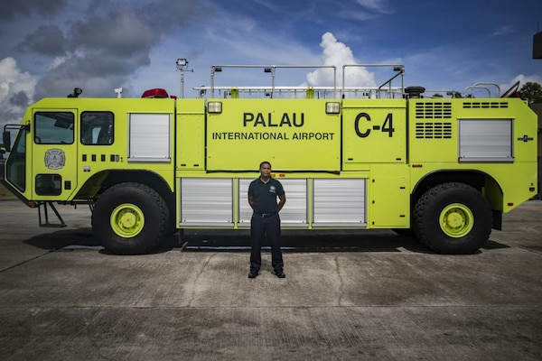 Dwayne Masami, the Palau Airport Rescue & Fire Fighting chief stands next to a firetruck in Airai, Republic of Palau, Sep. 2, 2021. The mission of the Palau Airport Rescue & Fire Fighting Division is to provide aircraft rescue, fire response and emergency medical services to the Palau International Airport. Task Force Koa Moana focuses on improving readiness and strengthening capabilities ahead of real-world crises.