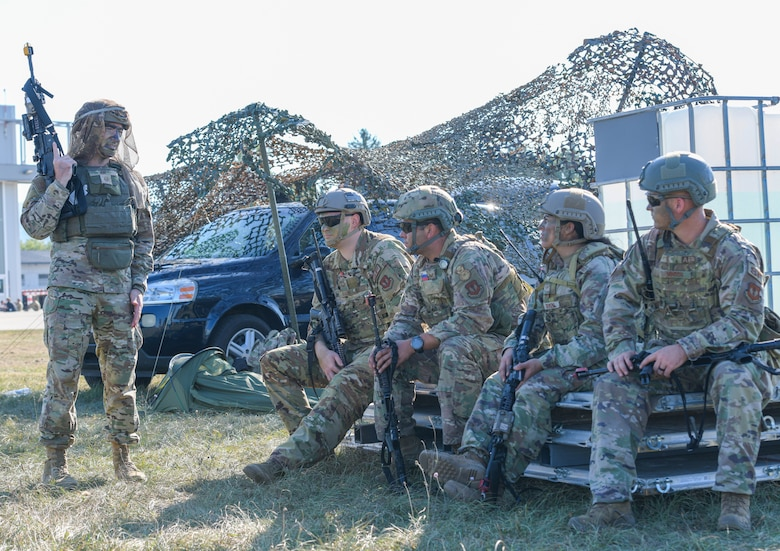 U.S. Air Force Master Sgt. Logan Ray, 31st Security Forces Squadron chief of standardization and evaluation, talks to his team before responding to a ground attack exercise at Cerklje ob Krki Air Base, Slovenia, Sept. 8, 2021. U.S. Soldiers assigned to the 173rd Airborne Brigade, United States Army Garrison, Italy, executed and simulated an airfield seizure while members from the 31st SFS practiced the measures needed to defend assets. (U.S. Air Force photo by Senior Airman Brooke Moeder)