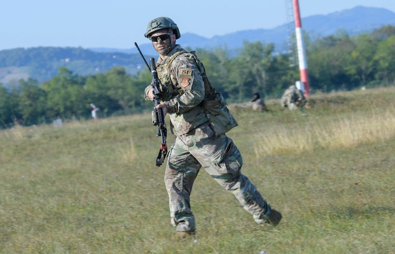 U.S. Air Force Staff Sgt. Dustin Minton, 31st Security Forces Squadron area supervisor, participates in contingency response to a ground attack exercise during Agile Wyvern at Cerklje ob Krki Air Base, Slovenia, Sept. 8, 2021. U.S. Air Force F-16 Fighting Falcons and Airmen assigned to the 31st Fighter Wing participated in exercise Agile Wyvern during which U.S. and Slovenian Armed Forces conducted Agile Combat Employment training. (U.S. Air Force photo by Senior Airman Brooke Moeder)