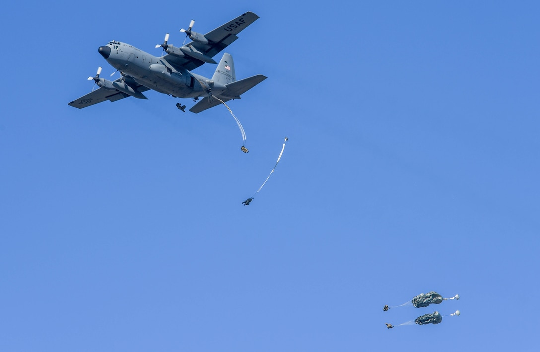 """U.S. Paratroopers from the 173rd Airborne Brigade jump out of a U.S. Air Force C-130 Hercules during exercise Agile Wyvern at Cerklje ob Krki Air Base, Slovenia, Sept. 8, 2021. Sky Soldiers of 2nd Battalion, 503rd Parachute Infantry Regiment """"The Rock,"""" merged with the 31st Fighter Wing's Agile Wyvern operations as part of their own separate exercise to show small unit proficiency, tactical competence and to solidify partnerships with the Slovenian 74th Infantry Regiment. (U.S. Air Force photo by Senior Airman Brooke Moeder)"""