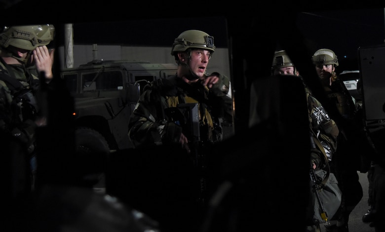 Senior Airman Alexander Westin, 51st Security Forces Squadron Defender, instructs teammates during a routine training event