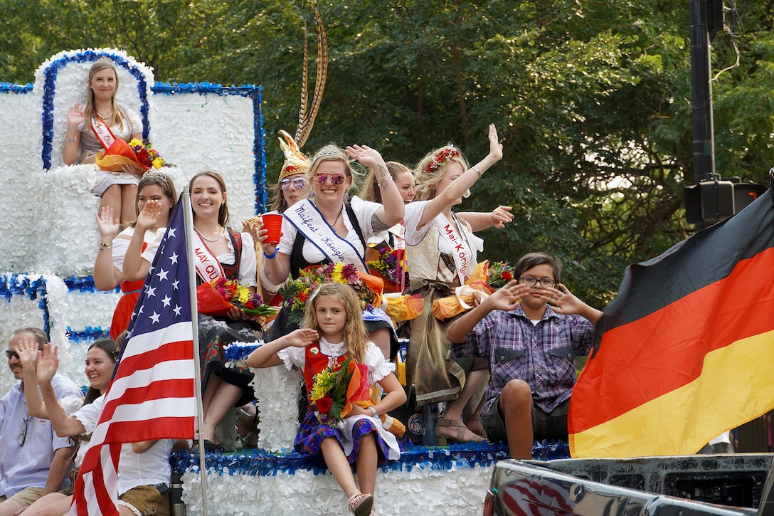 Former Maifest float queens wave to onlookers during Chicago's 55th Annual Steuben Parade, September 11, 2021.