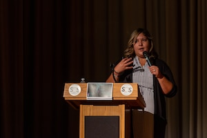 Laura Kane, founder and executive director of Marshmallow's HOPE, speaks to Airmen, civilians and family members during a suicide prevention presentation in the base theater at Edwards Air Force Base Calif., Sept. 1. (Air Force photo by Kyle Brasier)