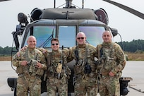 Left to right, U.S. Army Chief Warrant Officer 3 Albert Sbarro, Staff Sgt. Anthony Marotta, Sgt. 1st Class Timothy Witts, and Chief Warrant Officer 3 Quentin Hastings in front of their UH-60L Black Hawk helicopter at the New Jersey National Guard's Army Aviation Support Facility on Joint Base McGuire-Dix-Lakehurst, N.J., Sept. 14, 2021. They are part of a five-man crew that rescued nine people after catastrophic flooding in northern New Jersey from the remnants of Hurricane Ida.
