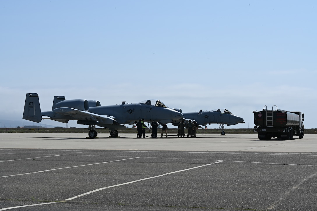 Two A-10 aircraft and a refueling truck