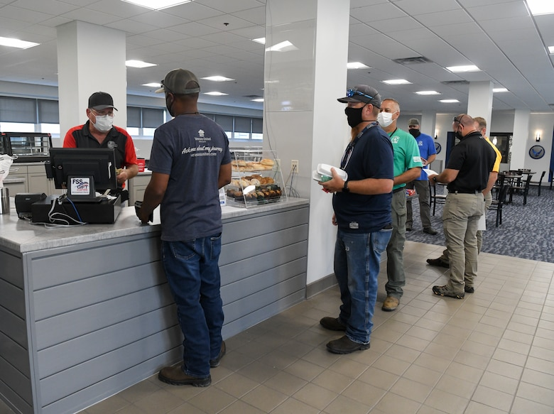 Steve Barnes, a Café 100 employee, serves customers, Sept. 9, 2021, at Arnold Air Force Base, Tenn. The dining facility reopened after a months-long renovation. (U.S. Air Force photo by Jill Pickett)