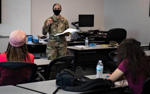 Tech. Sgt. Tia Morgan, Space Systems Command Senior Enlisted Leader's executive assistant, instructs participants of the Financial Peace University course at Los Angeles Air Force Base, California, Sept. 1, 2021. Morgan dedicated over nine weeks teaching the course which focused on the basic understanding of finance and budgeting. (U.S. Space Force photo by Staff Sgt. Elijah Jackson)
