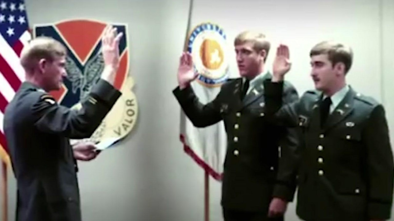 A man receives his Army commission