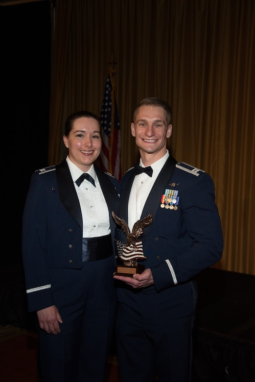 The Heffner couple pose with his recently presented Patriot Award.