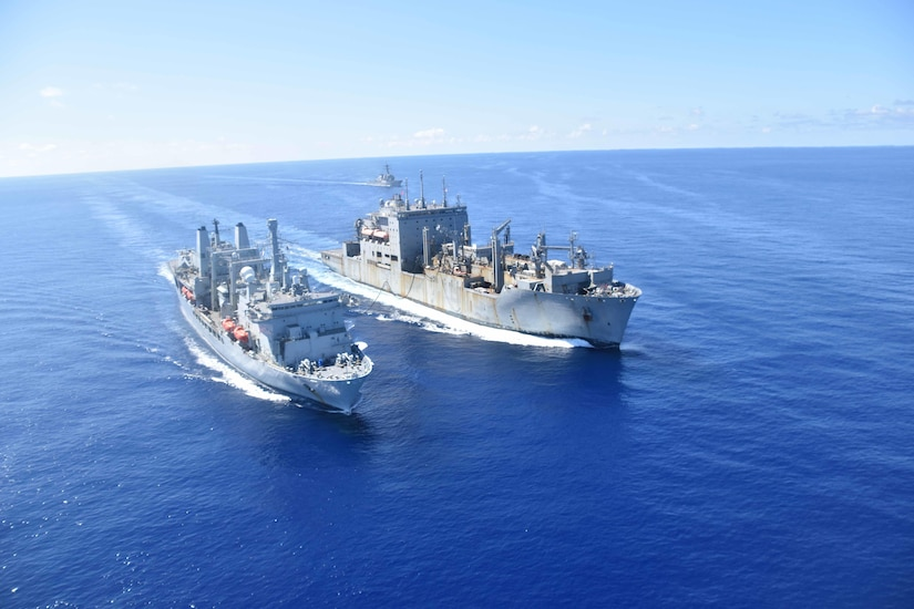 Ships sail side by side.