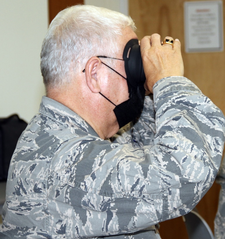 Chaplain (Col.) John Murdoch (left), CAP national chief of chaplains emeritus, tries the virtual reality headset for the Third Room application.