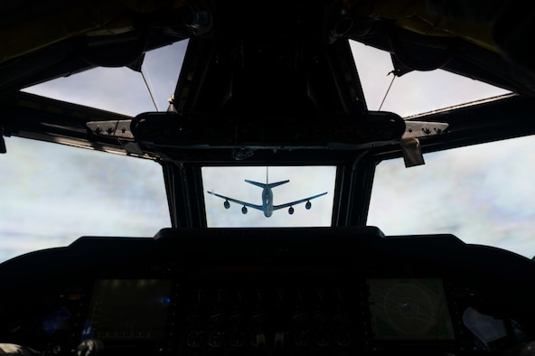 A U.S. Air Force KC-135 Stratotanker, assigned to the 117th Air Refueling Squadron, Kansas Air National Guard, prepares to refuel a B-52H Stratofortress, assigned to the 2nd Bomb Wing, Barksdale Air Force Base, Louisiana, over the Indo-Pacific region, during a Bomber Task Force mission, Sept. 14, 2021. The B-52 is a long range bomber with a range of approximately 8,800 miles, enabling rapid support of Bomber Task Force missions or deployments and reinforcing global security and stability. (U.S. Air Force photo by Staff Sgt. Devin M. Rumbaugh)