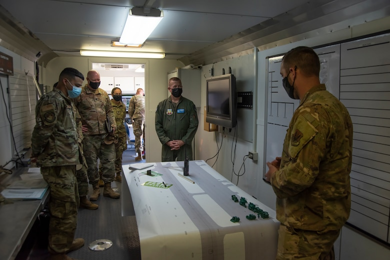 Airmen briefs the Colonel on how exercises are performed on runways.