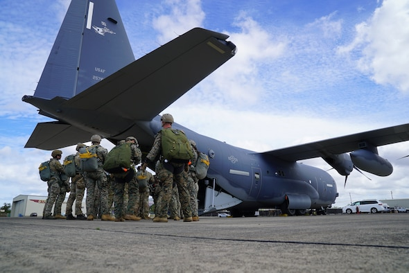 A team of Marines, Soldiers, and Airmen board an MC-130J Air Commando II assigned to the 353rd Special Operations Wing