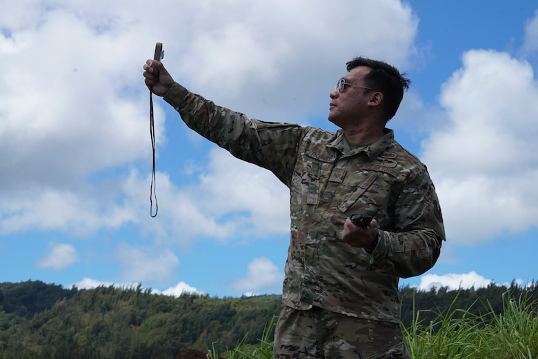 353 Aerial Delivery Support Branch Airmen gathers environmental data before an incoming equipment drop