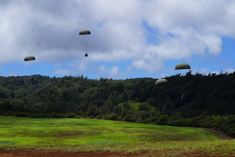 Equipment tied to parachutes drops over Kanes DZ, Hawaii