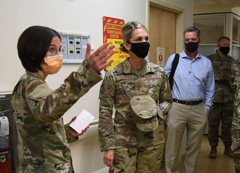 U.S. Air Force Maj. Suzanne Latch, 81st Inpatient Operation Squadron critical care nurse, briefs Maj. Gen. Michele Edmondson, Second Air Force commander, on the daily operations of the intermediate critical care unit (2D) during an immersion tour inside the Keesler Medical Center at Keesler Air Force Base, Missisippi, Sept. 13, 2021. While at the Medical Center, Edmondson also visited the Drive Up COVID Clinic to view the testing process first hand. (U.S. Air Force photo by Kemberly Groue)