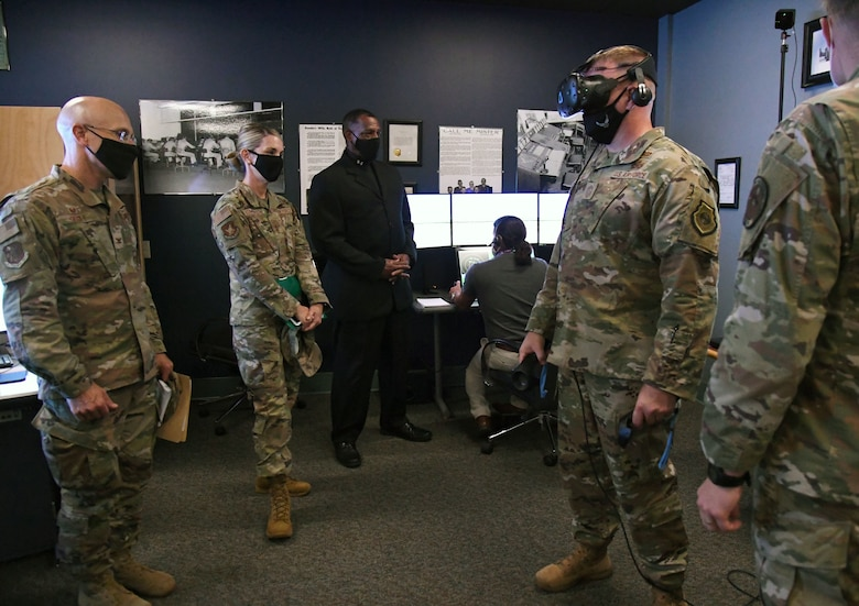 U.S. Air Force Maj. Gen. Michele Edmondson, Second Air Force commander, observes Chief Master Sgt. Adam Vizi, Second AF command chief, as he participates in a 334th Training Squadron virtual reality demonstration during an immersion tour inside Cody Hall at Keesler Air Force Base, Missisippi, Sept. 13, 2021. Edmondson toured the 81st Training Wing in order to become more familiar with its mission and capabilities. (U.S. Air Force photo by Kemberly Groue)