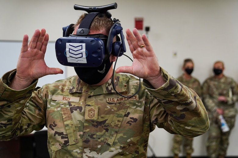 U.S. Air Force Chief Master Sgt. Adam Vizi, 2nd Air Force command chief, uses a virtual-reality system during an immersion tour at Keesler Air Force Base, Missisippi, September 13, 2021. The 2nd Air Force command team toured the 81st Training Wing as part of Maj. Gen. Michele C. Edmondson, 2nd Air Force commander, initial immersion visit to the installation since taking command of 2nd Air Force in July. (U.S. Air Force photo by Senior Airman Spencer Tobler)