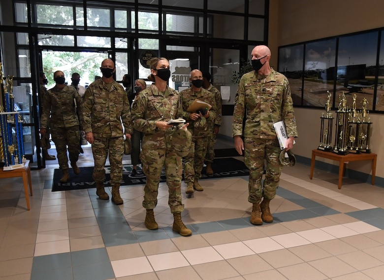 U.S. Air Force Maj. Gen. Michele Edmondson, Second Air Force commander, is escorted inside Cody Hall by Lt. Col. Matthew Hopkins, 334th Training Squadron commander, during an immersion tour at Keesler Air Force Base, Missisippi, Sept. 13, 2021. Edmondson toured the 334th TRS to observe innovations in air traffic control training. (U.S. Air Force photo by Kemberly Groue)