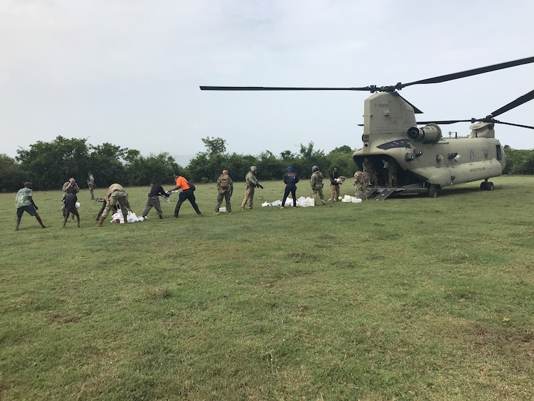 U.S. Air Force Special Tactics operators and other members of Joint Task Force-Haiti deliver humanitarian aid supplies to a remote part of the country. Special Tactics Airmen responded to a request to augment relief efforts in Haiti after a 7.2 magnitude earthquake hit the country Aug. 14, 2021.