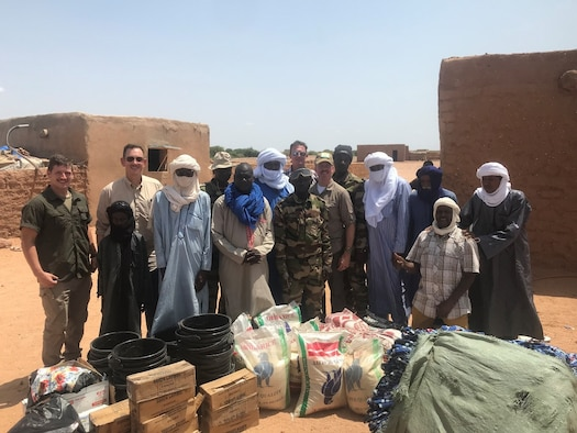 A member of the Forces Armees Nigeriennes Action Civil‐Militaire plays football with children in Teghazert, Niger on Sept 8, 2021.  Footballs, due to their popularity with the youth, are regularly donated along with other items. (Courtesy photo)