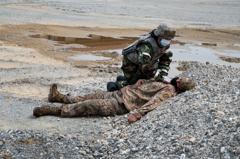 Capt. Danielle Miltenberg from the 51st Medical Group locates a mock deceased member during a mass casualty training event