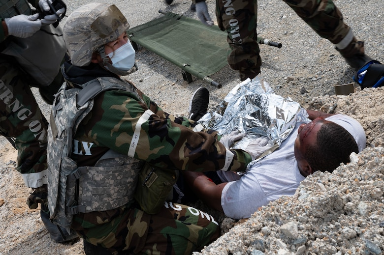 Capt. Danielle Miltenberg from the 51st Medical Group places a warming blanket on a patient during a mass casualty training event