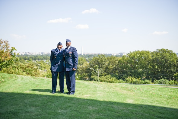 Image of two Airmen posing for a photo.