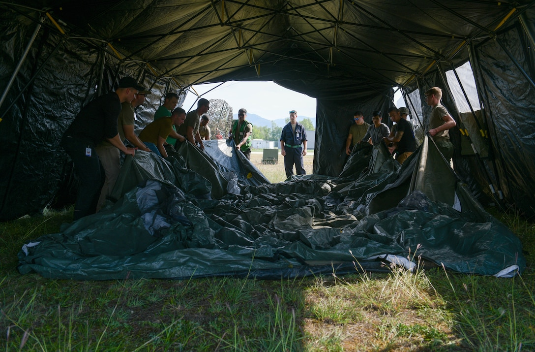 U.S. Air Force Airmen assigned to Aviano Air Base, Italy, assemble a tent in preparation for an Agile Combat Employment exercise at Cerklje ob Krki Air Base, Slovenia, Sept. 7, 2021. Exercises and deployments that utilize ACE concepts ensure the forces in Europe are ready to protect and defend partners, allies and U.S. interests at a moment's notice, and generate lethal combat power should deterrence fail. (U.S. Air Force photo by Senior Airman Brooke Moeder)