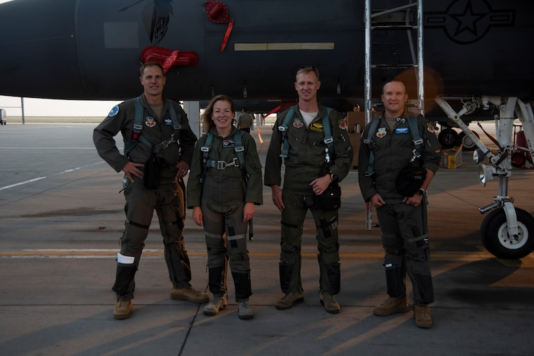 The Boise Mayor pose for a photo with Air Force pilots.