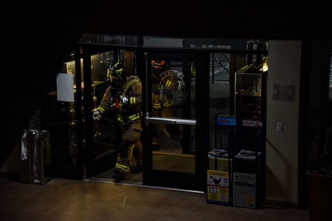 Firefighters from the 51st Civil Engineer Squadron enter a building during a training event