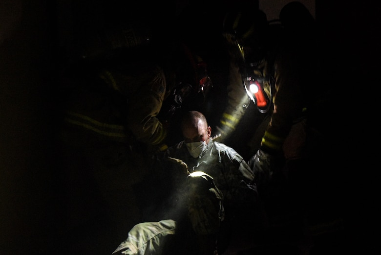 Firefighters from the 51st Civil Engineer Squadron discover a wounded Airman during a training scenario