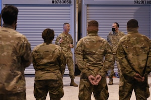 U.S. Air Force Brig. Gen. Gregory Kreuder, 56th Fighter Wing commander, left, and U.S. Air Force Chief Master Sgt. Daniel Weimer, right, 56th FW command chief, speaks with Airmen ahead of a temporary deployment to Joint Base McGuire-Dix-Lakehurst, New Jersey, Sept. 13, 2021, at Luke Air Force Base, Arizona. More than 40 Airmen from multiple units deployed to JB MDL in support of Operation Allies Welcome and Joint Task Force Liberty humanitarian efforts. Luke Airmen rapidly mobilized to answer the call for support with less than a four-day notice to assist with the sheltering of thousands of Afghan evacuees from Kabul, Afghanistan. (U.S. Air Force photo by Tech. Sgt. Amber Carter)