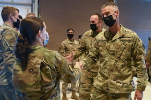 U.S. Air Force Brig. Gen. Gregory Kreuder, far right, 56th Fighter Wing commander, and U.S. Air Force Chief Master Sgt. Daniel Weimer, 56th FW command chief, offer well wishes to 56th FW Airmen ahead of a temporary deployment to Joint Base McGuire-Dix-Lakehurst, New Jersey, Sept. 13, 2021, at Luke Air Force Base, Arizona. More than 40 Airmen from the 56th FW deployed to JB MDL in support of Operation Allies Welcome, where they will assist with medical screenings, lodging, and other general support services for Afghan evacuees.. Luke Airmen rapidly mobilized to answer the call for support with less than a four-day notice to assist with the sheltering of thousands of Afghan evacuees from Kabul, Afghanistan. (U.S. Air Force photo by Tech. Sgt. Amber Carter)