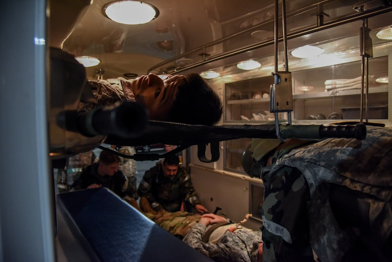 Airman 1st Class George Molina, 51st Civil Engineer Squadron augmentee, looks out of an ambulance as 51st CES firefighters and the 51st Medical Group Field Response Team load injured Airmen during a training event