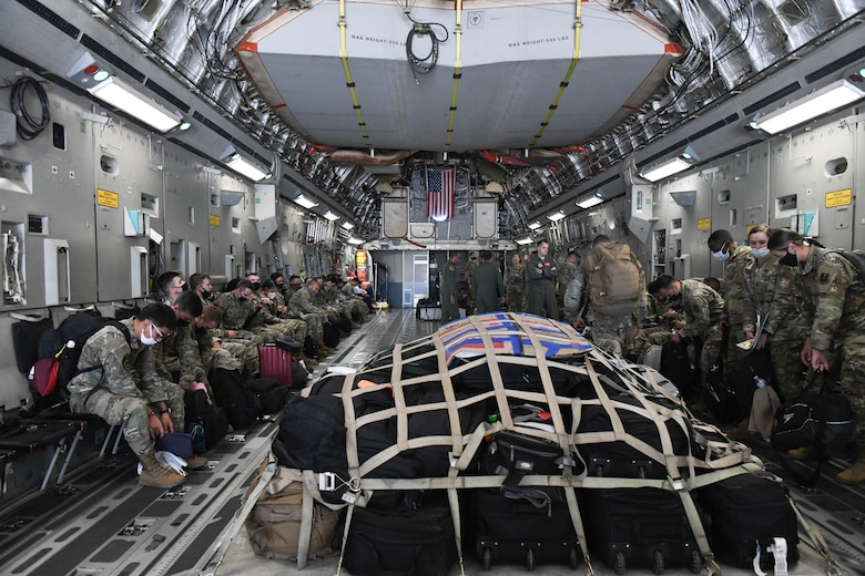U.S. Airmen from the 56th Fighter Wing board a C-17 Globemaster III Sept. 13, 2021, at Luke Air Force Base, Arizona. The C-17 from Altus Air Force Base, Oklahoma, will be transporting more than 40 Luke Airmen to Joint Base McGuire-Dix-Lakehurst, New Jersey, in support of Operation Allies Welcome. They will assist with medical screenings, lodging, and other general support services for Afghan evacuees. Luke Airmen rapidly mobilized to answer the call for support with less than a four-day notice to assist with the sheltering of thousands of Afghan evacuees from Kabul, Afghanistan. (U.S. Air Force photo by Tech. Sgt. Amber Carter)