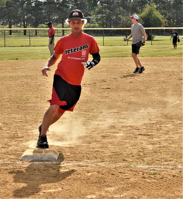 Younger James Delong rounds third base
