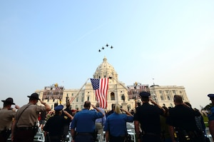 Four F-16 Fighting Falcons from the 148th Fighter Wing, Minnesota National Guard, fly over the Minnesota State Capitol, Sept. 11, 2021.